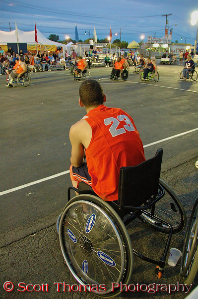 A wheelchair athlete waits for his chance to get into the exhibition basketball game during the New York State Fair in Syracuse.  [For Non-Commercial Editorial Use Only]
