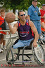 A wheelchair basketball player looks to make a pass during an exhibition game at the New York State Fair in Syracuse.  [For Non-Commercial Editorial Use Only]