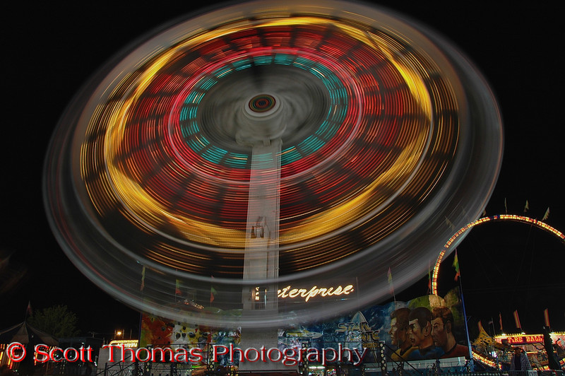 The popular thrill ride, Enterprise, on the New York State Fair Midway takes guests for a spin in Syracuse, New York.