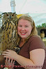 A young woman poses with a hawk owl in the Raptor Project exhibit at the New York State Fair in Syracuse.  [For Non-Commercial Editorial Use Only]