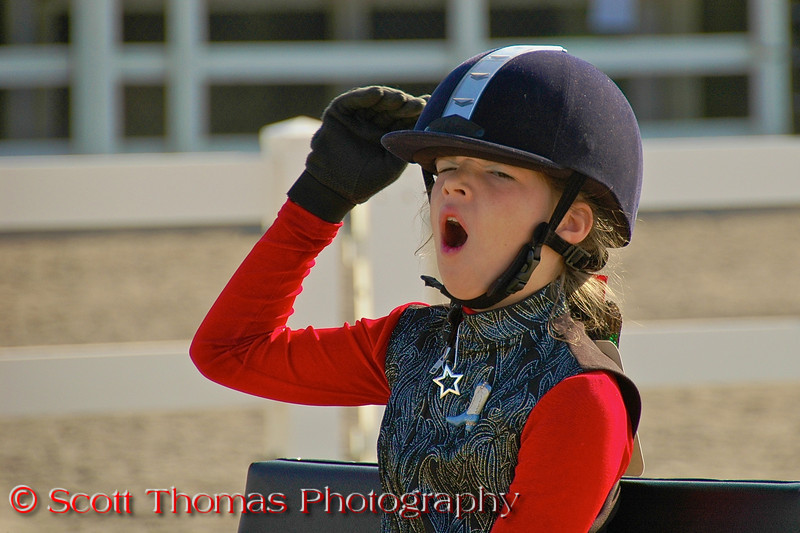 A young girl yawns while waiting to compete in a 4-H horse cart show at the New York State Fair in Syracuse.  [For Non-Commercial Editorial Use Only]