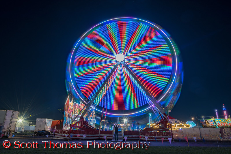 A big Ferris Wheel colors the night on the Midway at the New York State Fair near Syracuse, New York on Saturday, August 27, 2016.