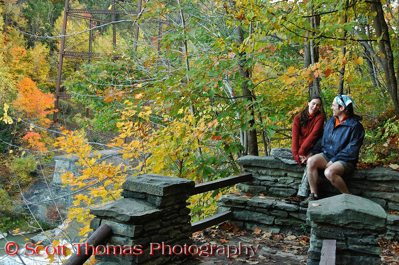 A couple takes a break from climbing the stone stairs found throughout Letchworth State Park on a cool, fall day near Castile, New York.
