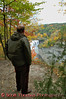 A hiker overlooks the Genesee River gorge and Middle Falls at Letchworth State Park.
