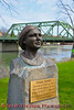 A bust of Diana Smith, the first female mayor of the Village of Seneca Falls, New York, near the Bridge Street Bridge on the Frank J. Ludovico sculpture trail.