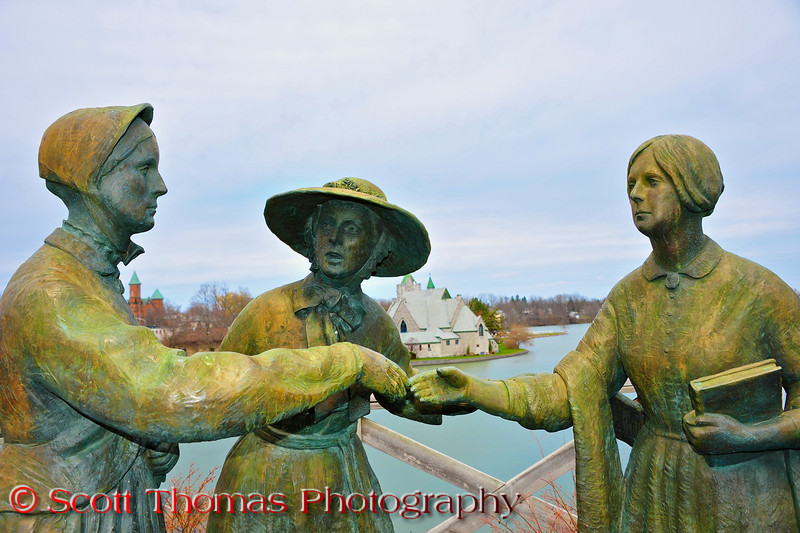 A statue in Seneca Falls, New York depicting the meeting between Susan B. Anthony (left) and Elizabeth Cady Stanton (right) by a mutual friend, Amelia Jenks Bloomer (center) in 1852
