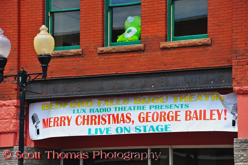 "A banner in Seneca Falls, New York announcing the location for the play, ""Merry Christmas, George Bailey"", performed each December."