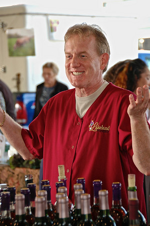 Andy Watkins, owner of the Lakeland Winery, at his booth in the Central New York Regional Market on Saturday, May 8, 2009.