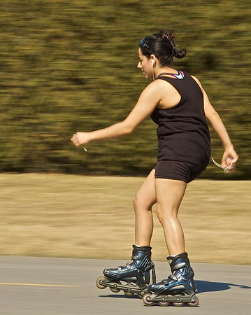 Roller Blader on an early Spring day in Onondaga Lake Park, Liverpool, New York.