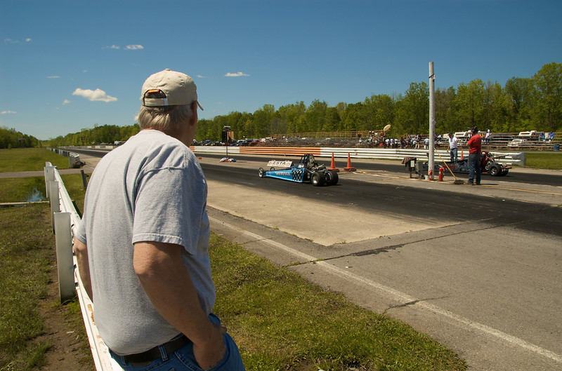 A Grandfather/Crew Chief watches his Granddaughter/Driver before the start of a Junior Dragster race at the ESTA Safety Park Dragstrip in Cicero, New York on Sunday, May 16, 2010.