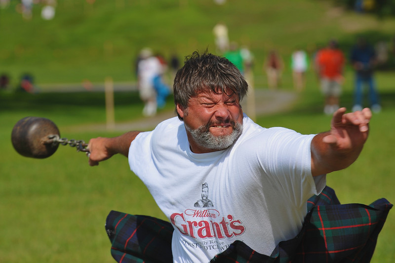 A competitor grimaces during  the 56 pound Stone Throwing event at the CNY Scottish Games at Long Branch Park in Liverpool, New York.  [For Non-Commercial Editorial Use Only]