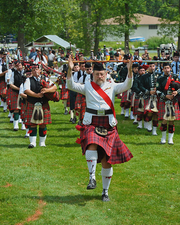 Pipe Major leading the Massed bands parade at the CNY Scottish Games at Long Branch Park in Liverpool, New York.  [For Non-Commercial Editorial Use Only]