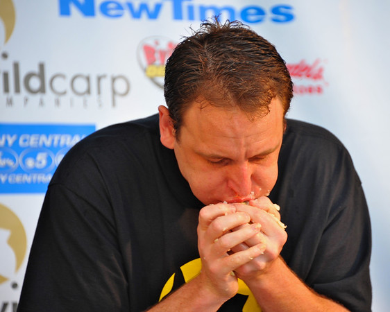 Joey Chestnut competing in the Wild Carp Week World Salt Potato Eating Championship on Paper Mill Island Budweiser Amphitheater stage in Baldwinsville, New York.