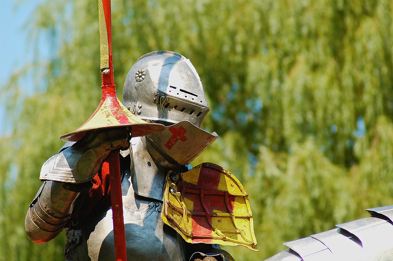 A knight in armour holds his lance before a joust at the Sterling Renaissance Festival near Oswego, New York.
