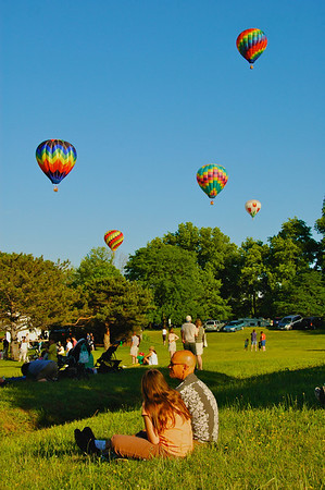 People watch hot air balloons at the Jamesville Balloon Fest near Syracuse, New York.