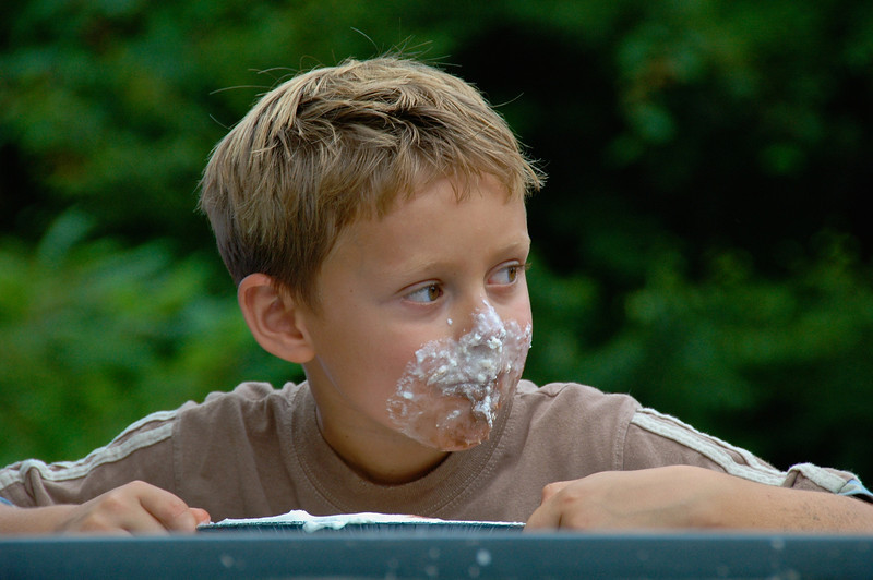 Boy comes up with a face full of whipped cream during the  pie eating contest at the Beaver Lake Nature Center's Golden Harvest Festival near Baldwinsville, New York.  [For Non-Commercial Editoral Use Only]