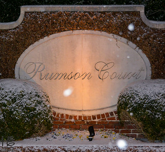 02-13-14 The neighboring townhouse sign lit up on a snowy night.
