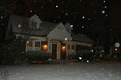 02-13-13 Orbs among the snow falling around a neighborhood home.