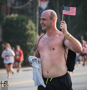Runner carrying flag