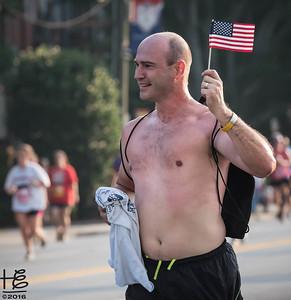 Runner carrying flag