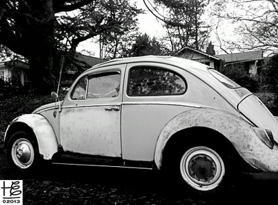 12-25-12 An antique VW complete with signs of the wear and tear of long life.
