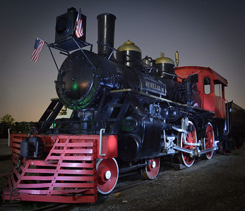 "07-12-14  Railroad engine ""painted with light"" in the Super Full Moon light.  Note the trees in the background are moon lit yet the train is lit by painting with a flash light.  This picture was team effort with dear friend Marina Bryant."