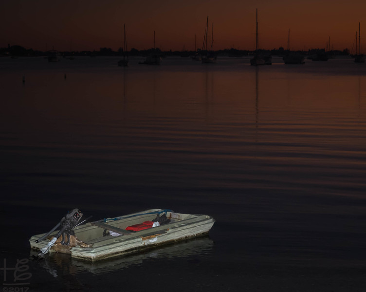 Dinghy in the bay at sunset