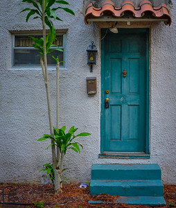 An older apt blue door