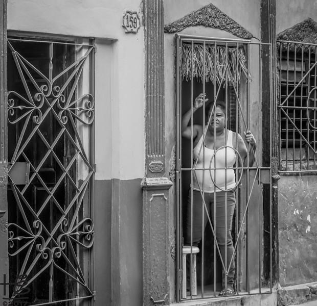 Cuban woman at her front door