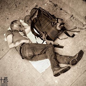 Man sleeping on pavement