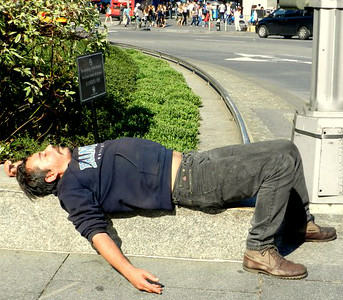 10-05-12 A man found a comfortable sleeping spot on Columbus Circle in NYC in the early afternoon Indian Summer Sun.