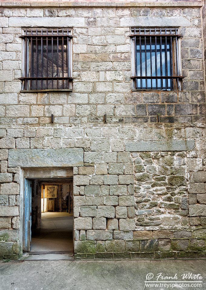 3 windows and a doorway