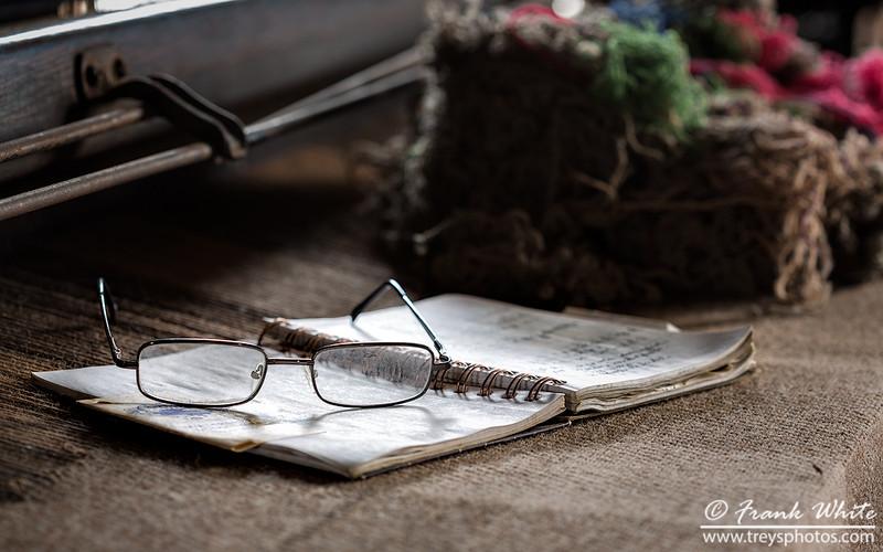 Ledger and glasses