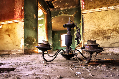 Rusty Lamp on the Ground of an Abandoned House