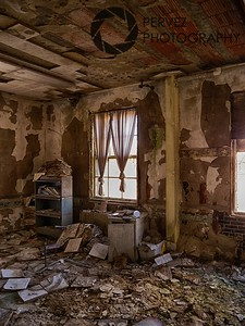 Room in ruins (but the drapes are still tied) in the abandoned Forest Haven asylum, one of America's most notorious mental institutions. The asylum, in Laurel, Maryland, has been abandoned for about 25 years.