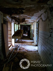 Creepy hallway in a dormatory in the abandoned Forest Haven asylum, one of America's most notorious mental institutions. The asylum, in Laurel, Maryland, has been abandoned for about 25 years.
