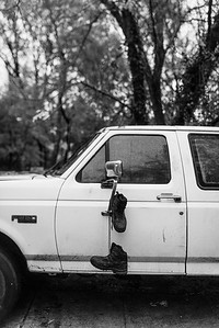 Baltimore -- Gready hangs his boots on the stable's truck, which finally got fixed after months of not working. Nov. 9, 2018.