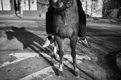 Baltimore -- Gready rides Pimp bareback around Hollins Market on Feb. 24, 2019. Photo by Eric Lee