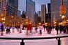 CHI 009                         <br />  Skaters circle the rink at Skate on State in Millenium Park, Chicago, IL.
