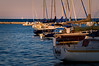 CHI 005                         <br /> Sailboats rest peacefully at their moorings as the sun sets on Burnham Harbor, Chicago lakefront.