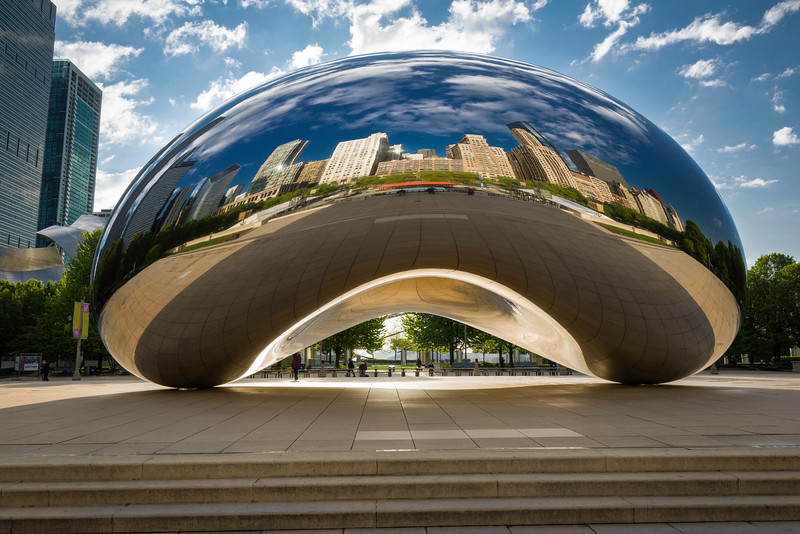 CHI 055<br /> <br /> Early morning light illuminates the reflective surface of the stainless steel sculpture, Cloud Gate, a favorite among tourist from around the world.   AT&T Plaza, Chicago, Illinois.