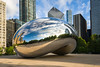 CHI 054<br /> <br /> Early morning light illuminates the reflective surface of the stainless steel sculpture, Cloud Gate, a favorite among tourist from around the world.   AT&T Plaza, Chicago, Illinois.
