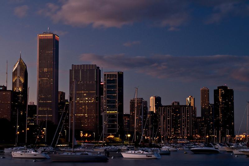 CHI 003                        <br /> Dusk settles in over boats in Burnham Harbor, Chicago lakefront.