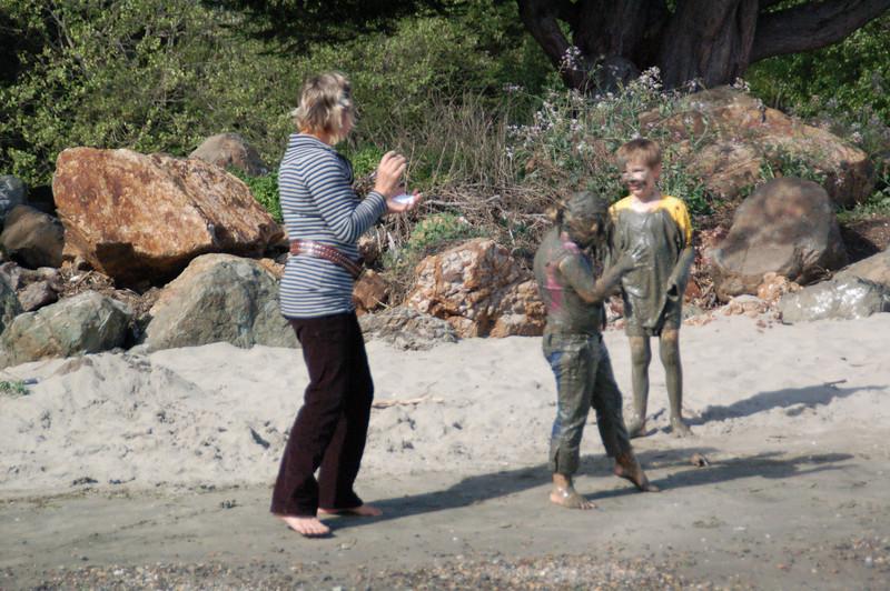 Crab Cove, Alameda California.  Muddy kids and their mom. April 11, 2007