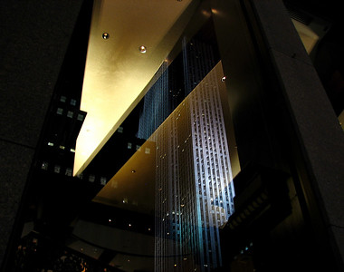 Rockefeller Center reflected in a window at night