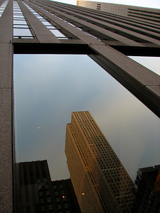 Rockefeller center reflected in a window
