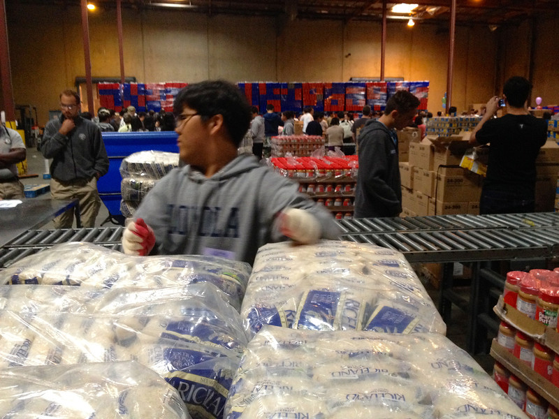 Saturday morning was taken up with three hours work on the assembly line, producing 6,000 bags of groceries for the needy. Warehouse was huge and located in Vernon.  Here rice detail. 4/12/2014