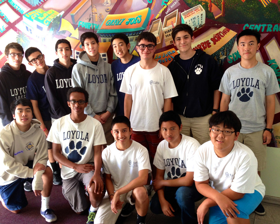 Murals are a part of Urban Plunge and adorn skid row. This mural shows downtown and skid row. Boys pose in entrance way to Cardinal Manning Center on Winston Street. 4/12/14.