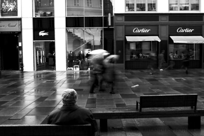 Cartier Watcher  Watching shoppers walking, boys playing.