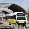 DART (Dallas Area Rapid Transit) Kinki Sharyo Super Light Rail Vehicle (SLRV) No. 120 departing Trinity Mills Interchange Station.